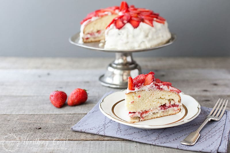 Strawberry Cake Recipe With Buttercream Frosting. Besides eating them freshly picked, this strawberry cake recipe is one of my favorite ways to enjoy fresh strawberries. It's easy to put together because it starts out with white cake mix,and strawberry gelatin. Only a few more ingredients are needed. It has the best strawberry flavor and is wonderfully moist. The only thing that makes the cake better is the buttercream frosting! #strawberryrecipes #strawberrydessertrecipes #dessertrecipes #cakerecipes #easycakerecipes #strawberries #strawberrycakerecipe