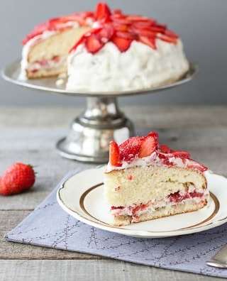 Besides eating them freshly picked, this strawberry cake recipe is one of my favorite ways to enjoy fresh strawberries. It's easy to put together because it starts out with white cake mix,and strawberry gelatin. Only a few more ingredients are needed. It has the best strawberry flavor and is wonderfully moist. The only thing that makes the cake better is the buttercream frosting!