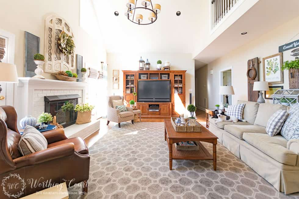 I love seeing the before and after transformation of any room. This family room was taken from a dated room fill with dark, heavy traditional furniture and turned into a bright room filled with farmhouse touches.