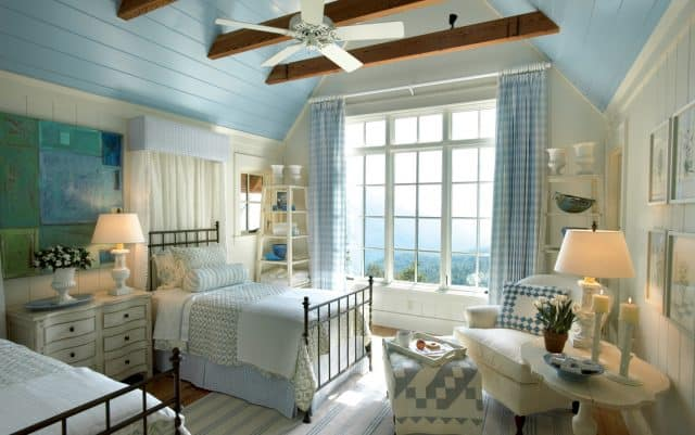 A beautiful and inviting bedroom decorated in blue and white.