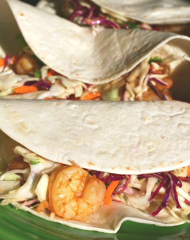 In addition to the ease of prep and tastiness of this shrimp taco recipe, I love the versatility of it. If you aren't a shrimp lover, try substituting grilled tilapia in its place. The recipe calls for adding a slice of avocado to each taco. I prefer to eat my avocado on the side, so I add a little salsa instead. Use your imagination and you can create a dish that your family will totally love!