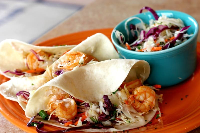 In addition to the ease of prep and tastiness of this shrimp taco recipe, I love the versatility of it. If you aren't a shrimp lover, try substituting grilled tilapia in its place. The recipe calls for a sliced avocado. I prefer to eat my avocado on the side, so I add a little salsa to the tacos instead. Use your imagination and you can create a dish that your family will totally love!