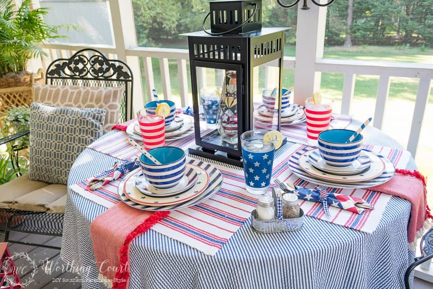 A Patriotic Table Setting On Farmhouse Porch Filled With Loads Of Red White And