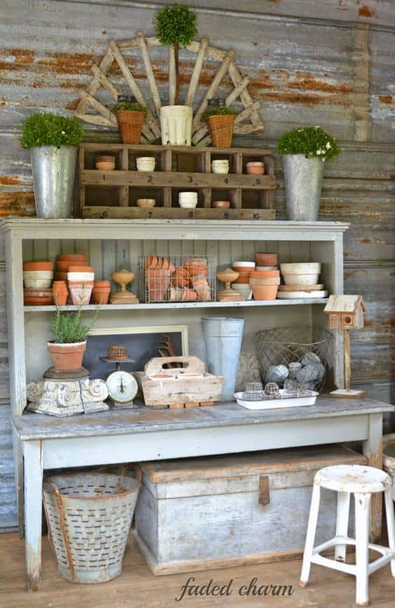 The terra cotta pots being used as decorative accessories on open rustic shelves.