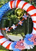 Step by step directions for how to make a patriotic wreath with supplies from the dollar store.