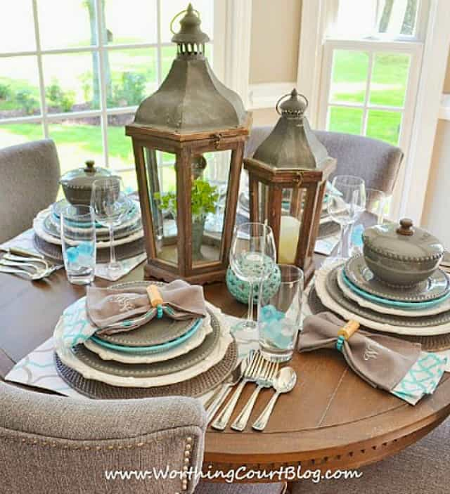round table set with gray and blue dishes