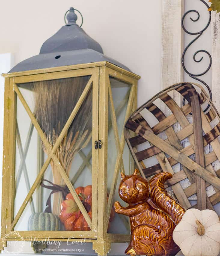 How To Decorate With Lanterns - fill a large lantern with a wheat sheaf and pumpkins for a fall display