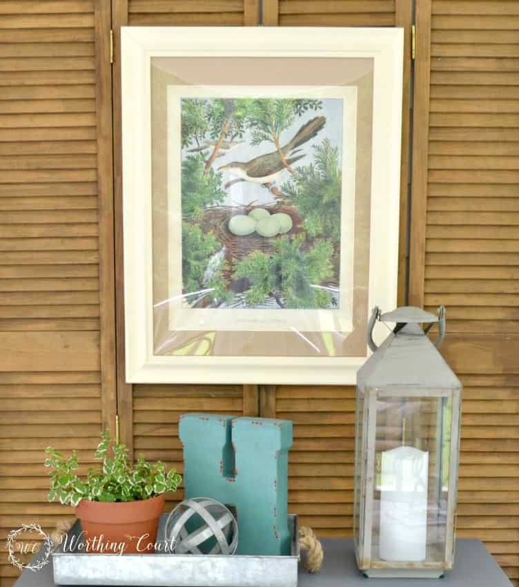 Outdoor vignette using an old bifold door as a backdrop