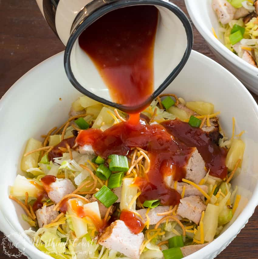 Savory grilled pork and sweet bbq dressing are the perfect compliment to one another in this easy and fast to make Grilled Pork Asian Salad.
