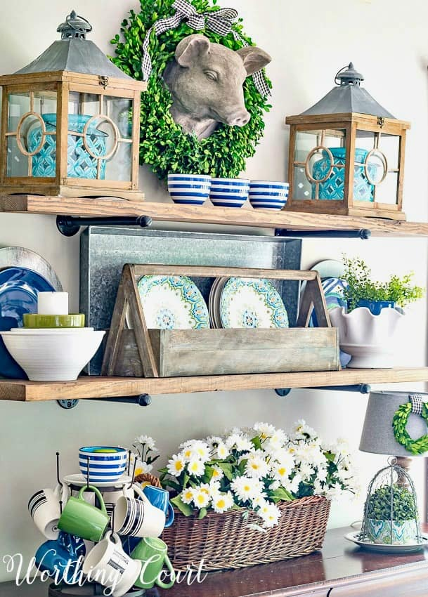 Open shelves decorate with blue, white and green accessories