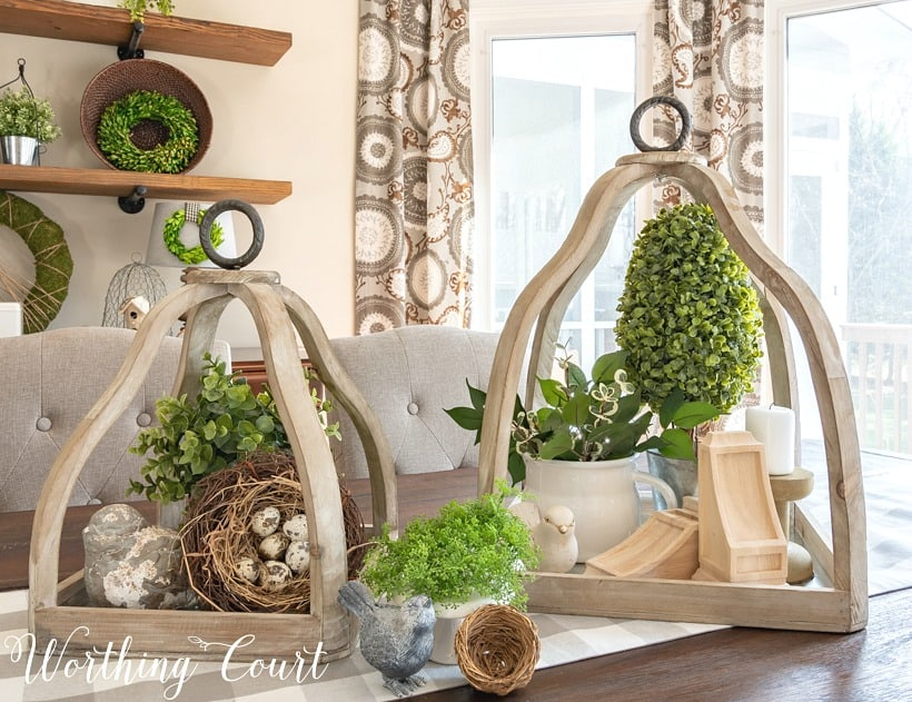 wood lanterns with greenery