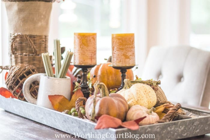 When determining how to make a centerpiece, remember that if you are going display your centerpiece in a tray with sides, you'll need to use tall items or else elevate the smaller ones. #falldecor #howto #tips || Worthing Court