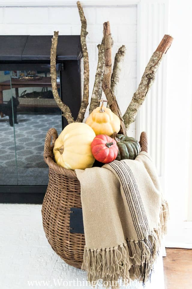 Fill a basket with sticks from your yard, a throw and multiple pumpkins for an easy fall display    Worthing Court Blog