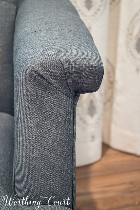 Gray tufted arm chair from Hayneedle arm detail