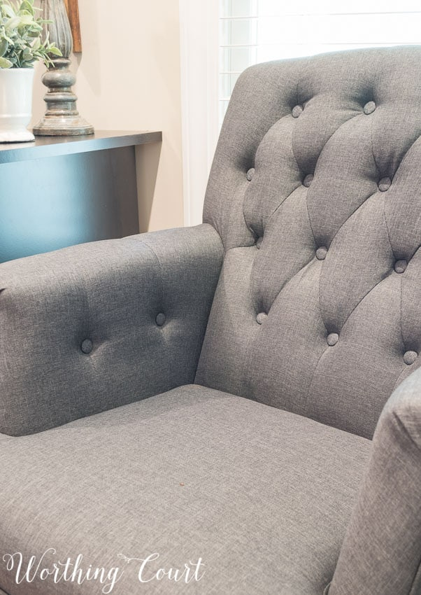 Gray tufted arm chair from Hayneedle- diamond tufting detail