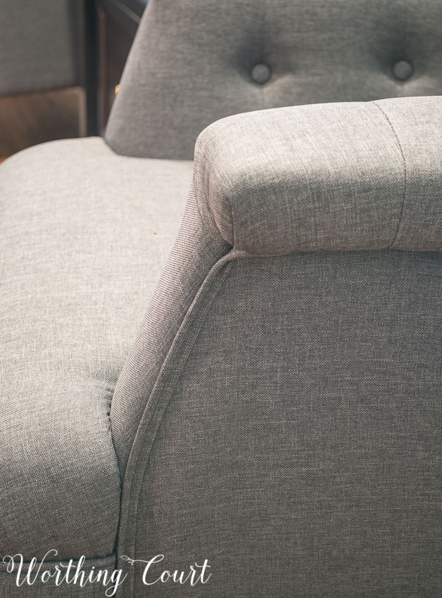 Gray tufted arm chair from Hayneedle- welting detail