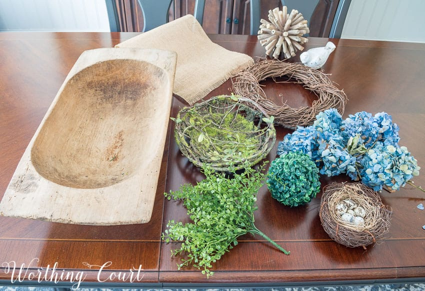 Decorative items needed to create a spring dough bowl display.