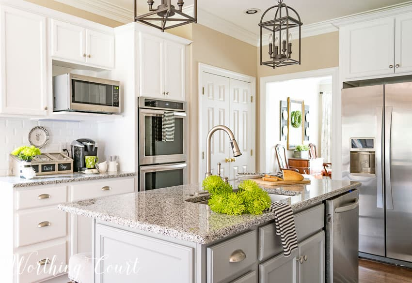 kitchen with white shaker cabinets and wall ovens