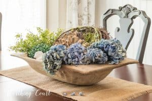dough bowl filled with spring decorations
