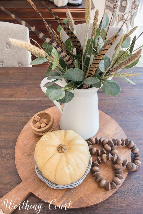 Overhead view of an easy fall centerpiece in the centre of the farmhouse table.