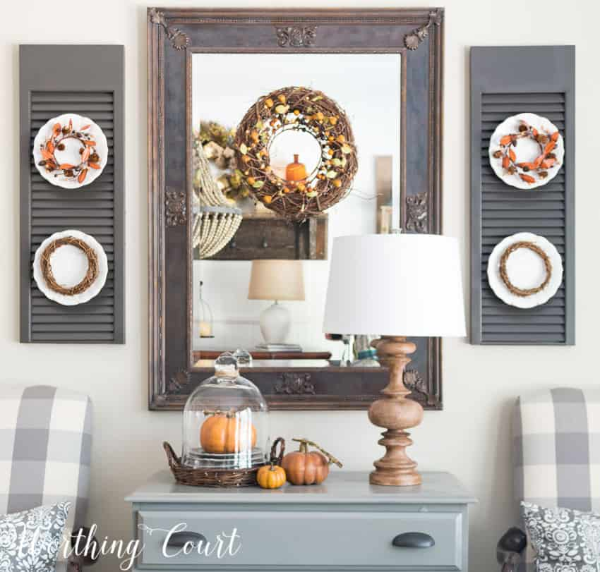 Fall dining room mirror and shutters with plates || Worthing Court