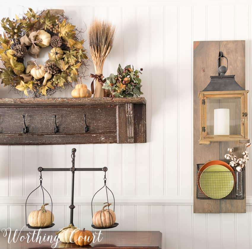 Fixer Upper style hanging lanterns and baskets dressed up for fall