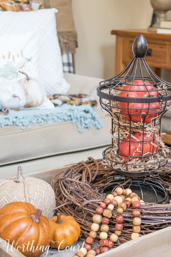 Add strands of craft beads for fall texture to a vignette || Worthing Court