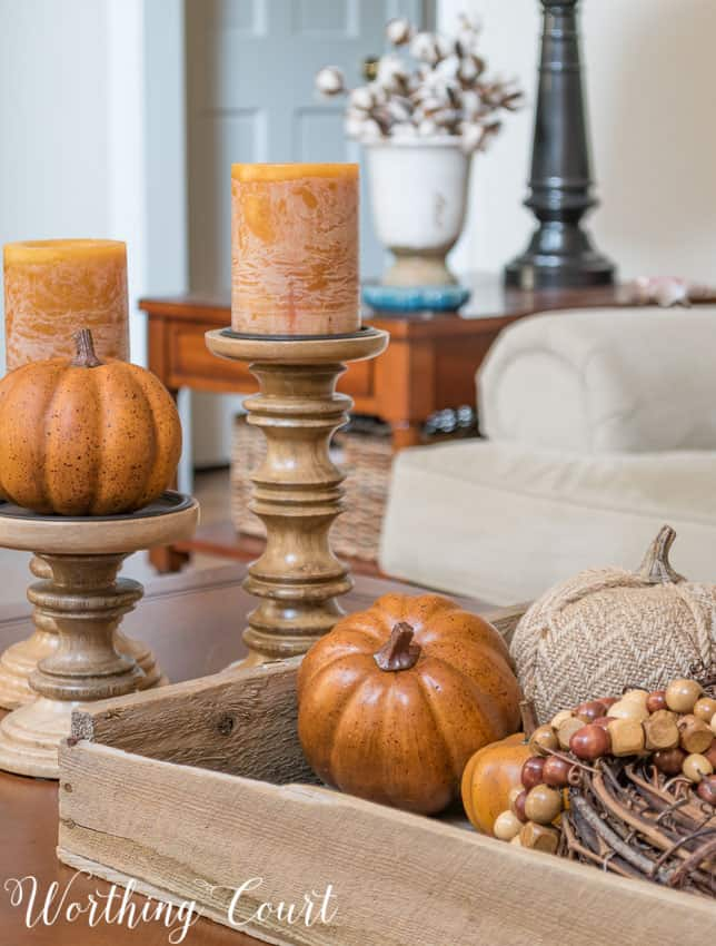 Fall vignette using an old planter's tray and candlesticks on a coffee table || Worthing Court