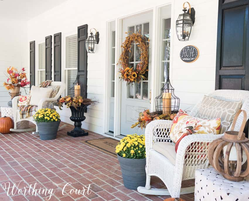 Fall front porch with wicker rockers and fall urns || Worthing Court