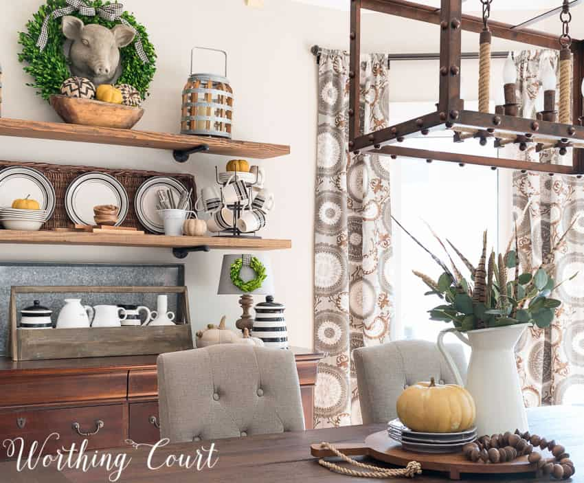 Fall rustic open shelves and centerpiece in the dining room.