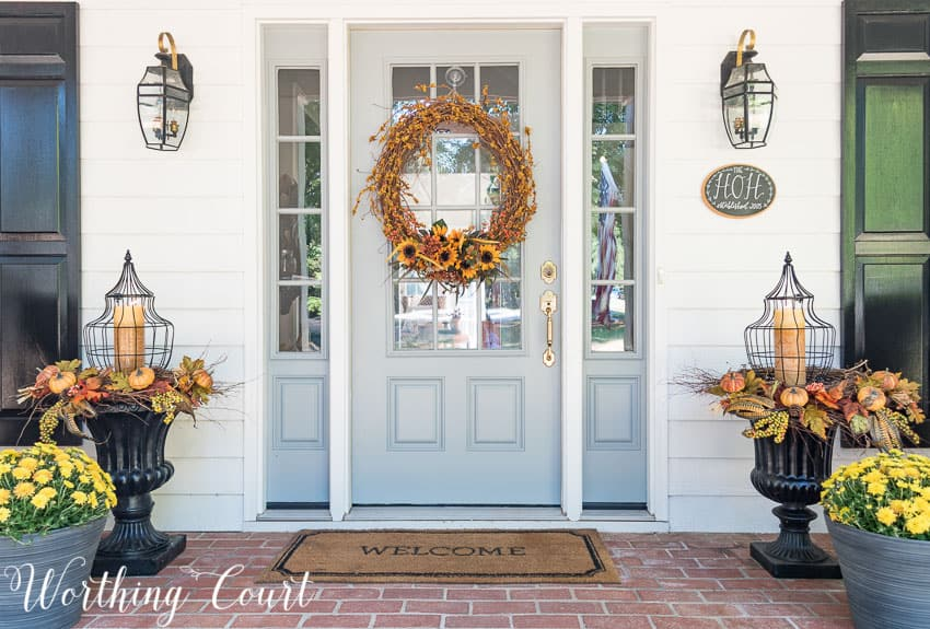 Farmhouse front entry with fall urns || Worthing Court