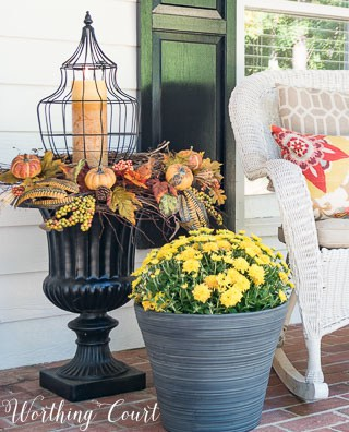 Fall urn with a lantern surrounded by twig wreaths and fall picks || Worthing Court