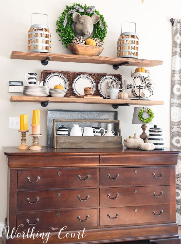 Rustic open shelves decorated for fall with wood tones, soft golds and black and white || Worthing Court