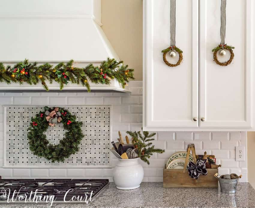 Twigs wreaths on the cabinets and a garland on the hood - all attached with Command Strips