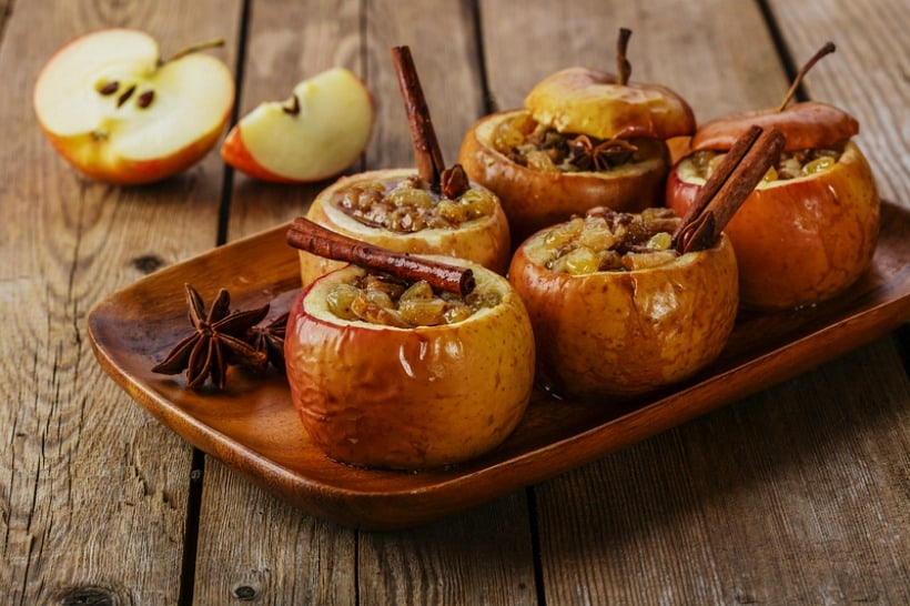 The baked stuffed apples with cinnamon sticks.