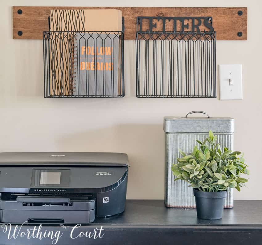 Hanging baskets for mail storage || Worthing Court