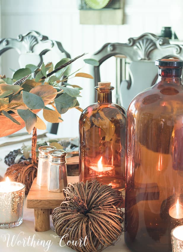 Brown glass jugs as part of a Thanksgiving table centerpiece || Worthing Court