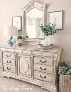 dresser and mirror painted white with brown glaze