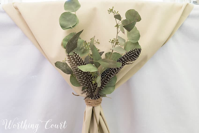 Try gathering a table runner on the ends, tying it with twine and tucking in a few natural elements for your Thanksgiving table || Worthing Court