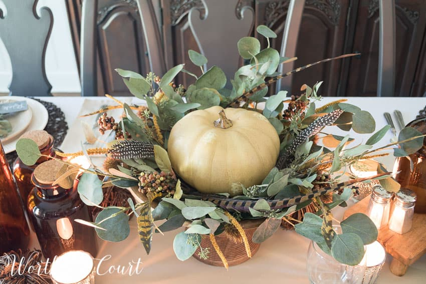 Thanksgiving centerpiece using a faux pumpkin, eucalyptus leaves and feathers || Worthing Court