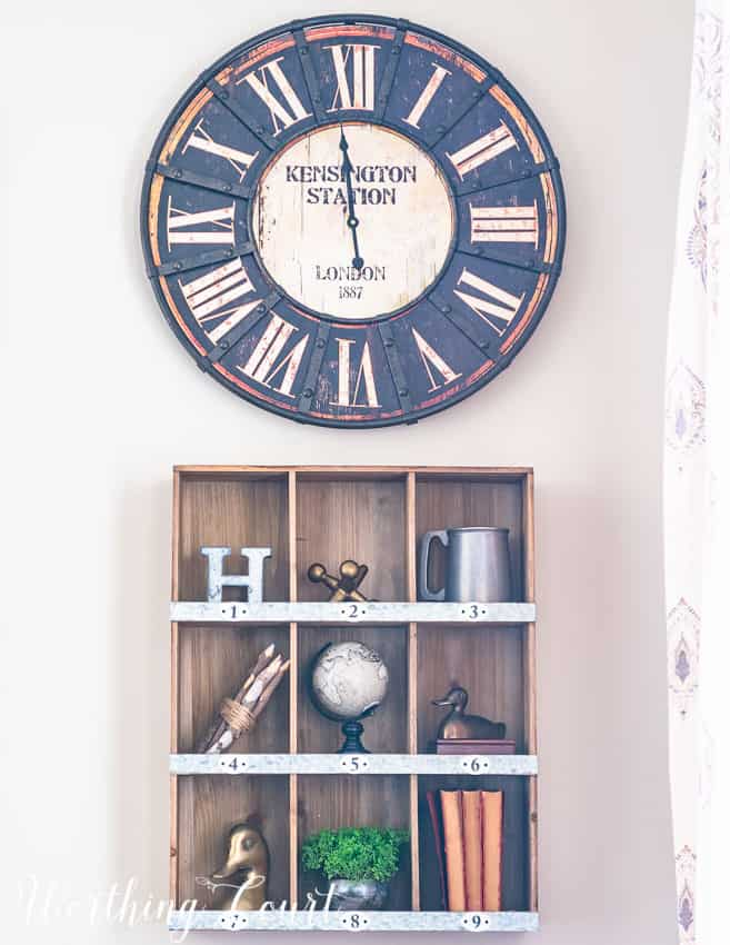 wall-decor-using-a-rustic-clock-and-cubbies-filled-with-vintage-items