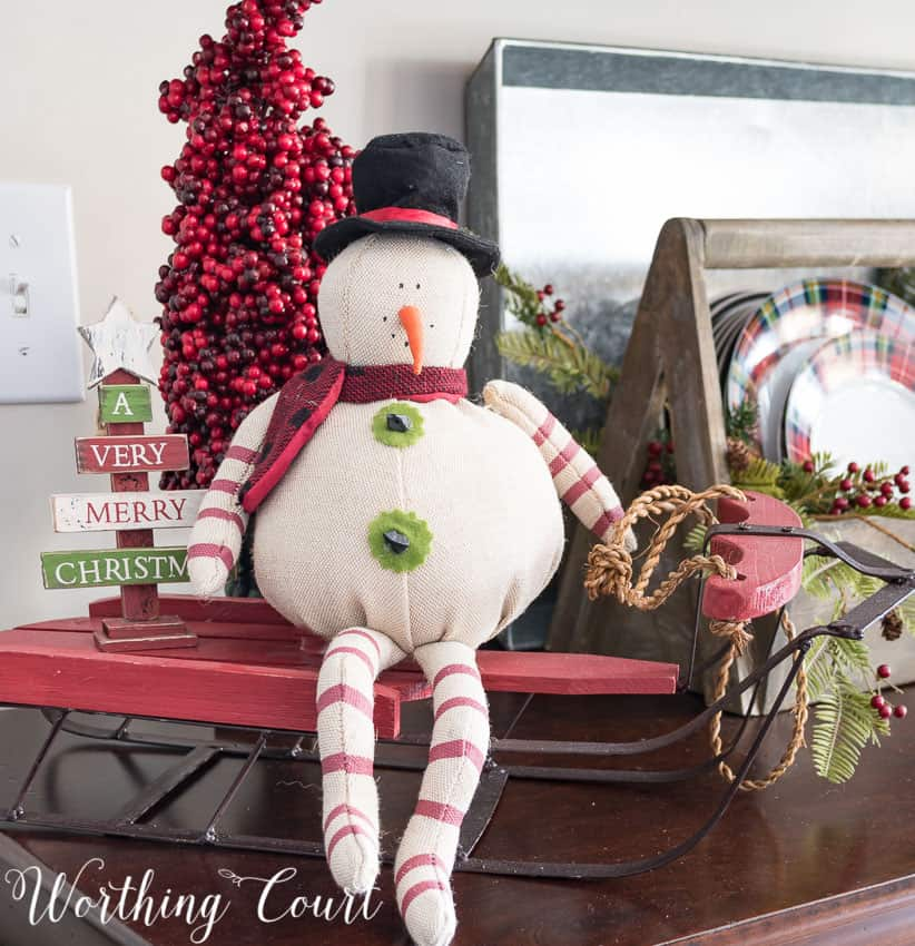 Christmas vignette with a primitive snowman and sled || Worthing Court