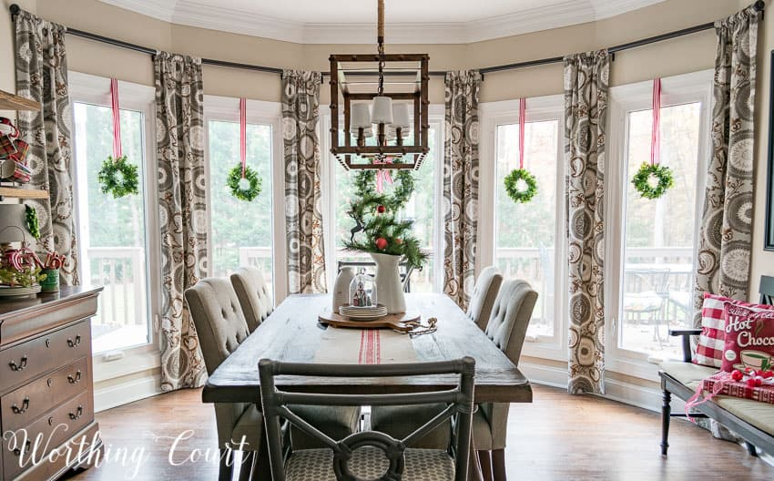 Christmas breakfast nook with wreaths in the bay window || Worthing Court