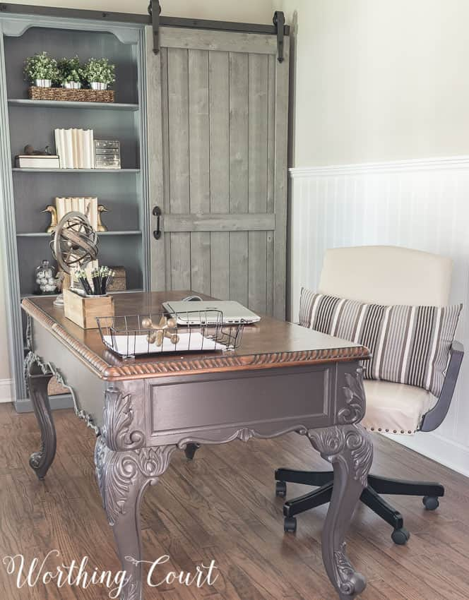 Up close picture of the desk and the barn door bookcase.