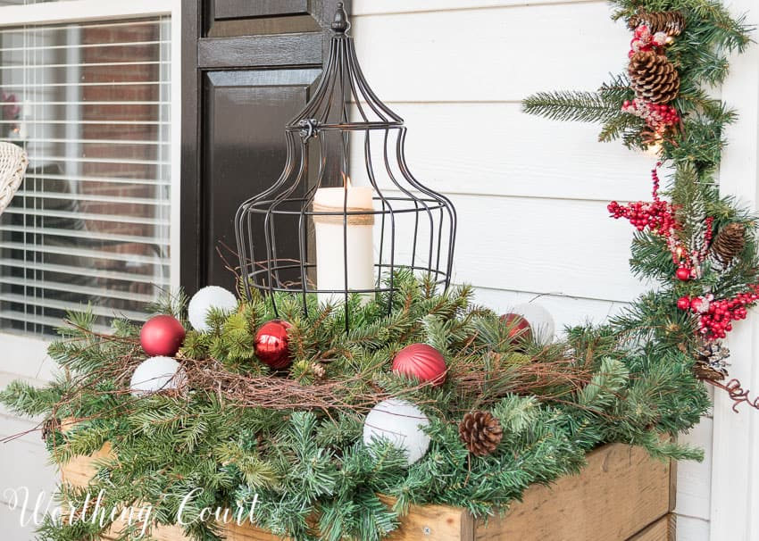 DIY wood planters filled with Christmas greenery and lanterns || Worthing Court
