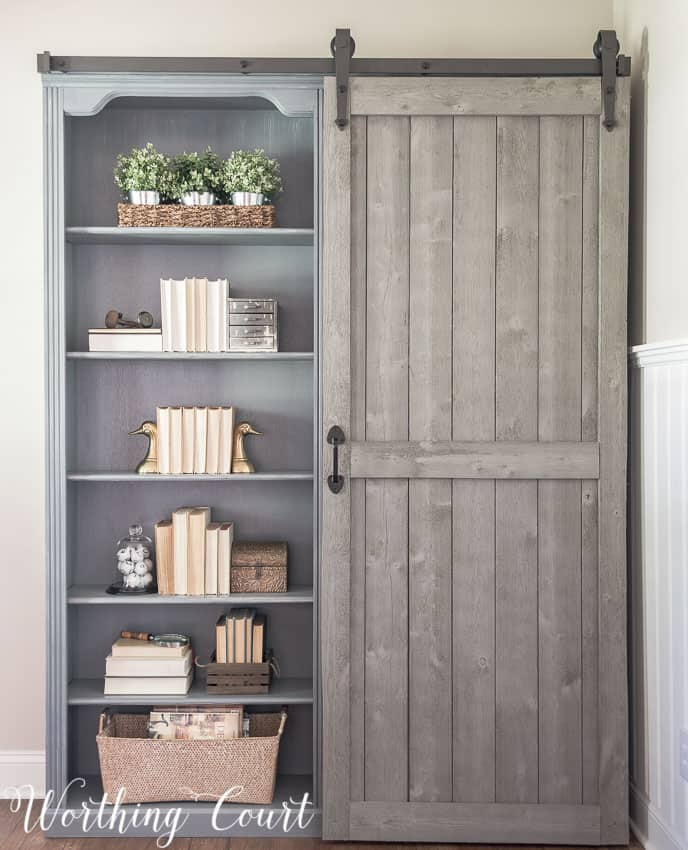 Farmhouse style bookcases with a sliding diy barn door