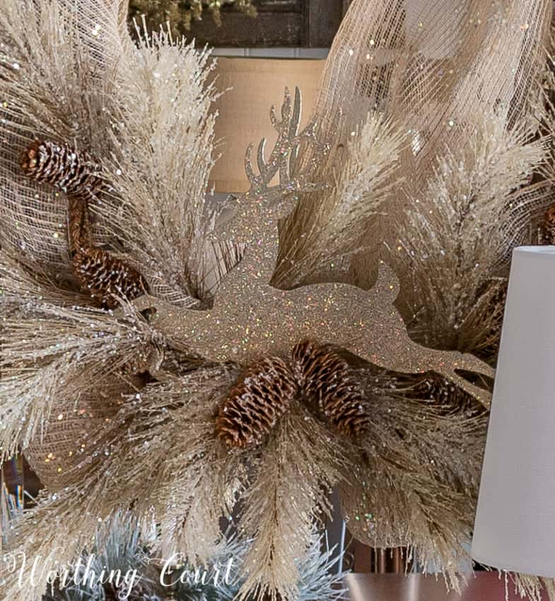 glittered reindeer and frosted natural colored faux pine branches on a diy Christmas wreath || Worthing Court