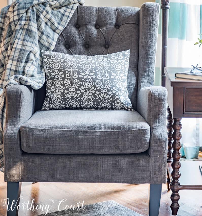 Gray wing chair with tufted back || Worthing Court