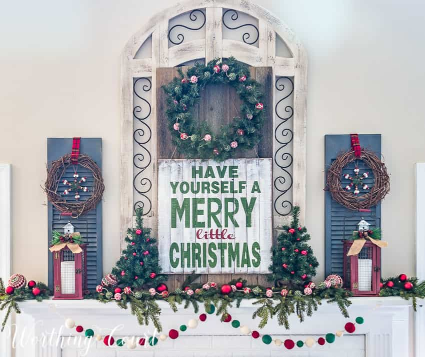 Have yourself a Merry Little Christmas sign on the decorated mantel.