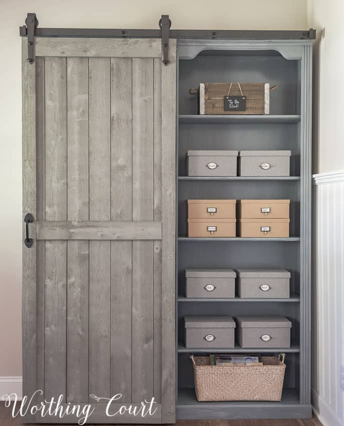 Bookcase makeover traditional cherry to farmhouse fab for Ikea barn door hardware